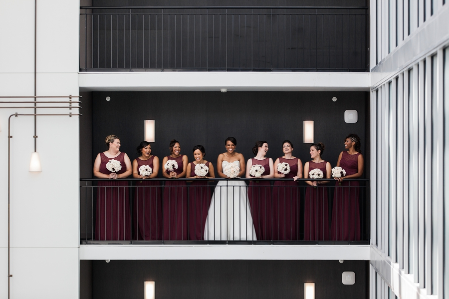 bride laughing with bridesmaids at The Hilton Downtown Columbus
