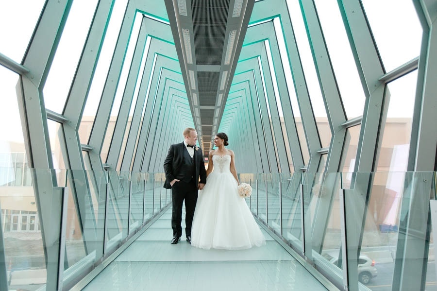 married couple on sky bridge at The Hilton Downtown Columbus