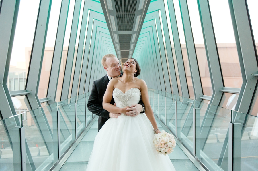 married couple laughing on sky bridge The Hilton Downtown Columbus