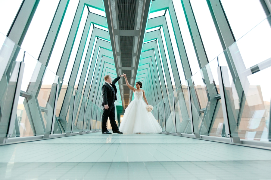 married couple dancing on sky bridge at The Hilton Downtown Columbus