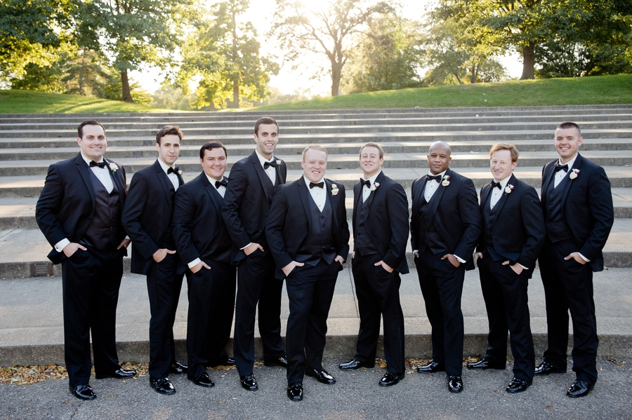 groom with groomsmen at sunset