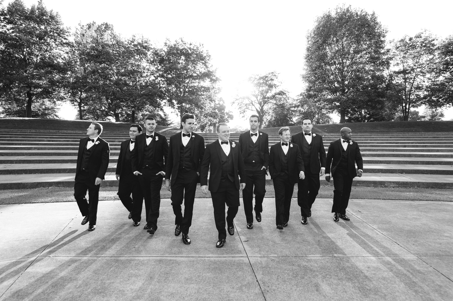groomsmen walking at sunset