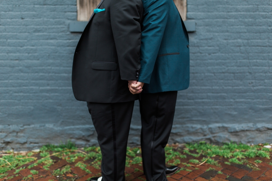 groom holding grooms hand