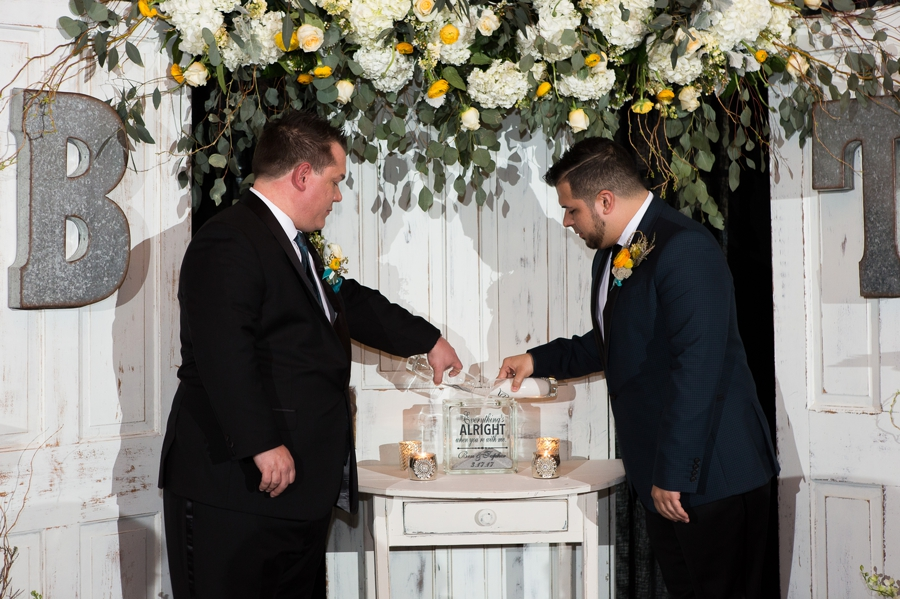 sand ceremony with same sex couple