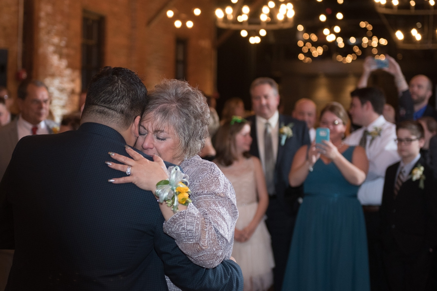 mother of groom emotional during dance at High Line Car House