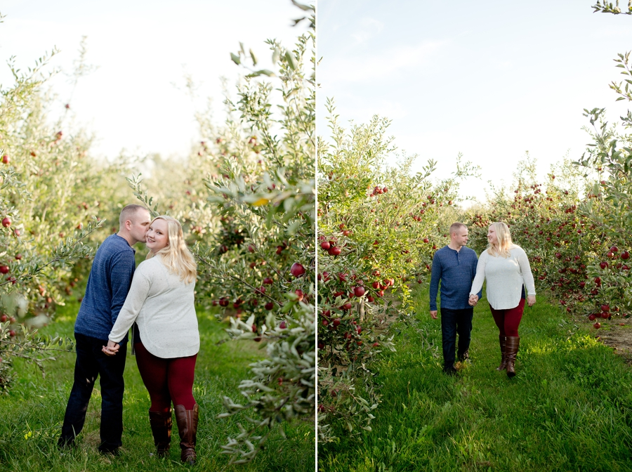 engaged couple walking through Lynd's Fruit Farm
