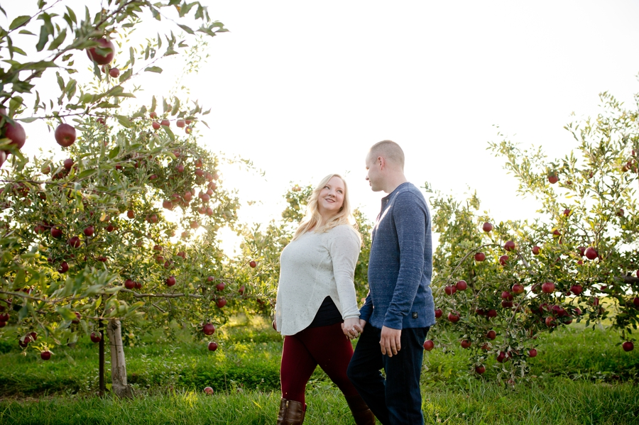 engaged couple at apple orchard in Patakala, OH