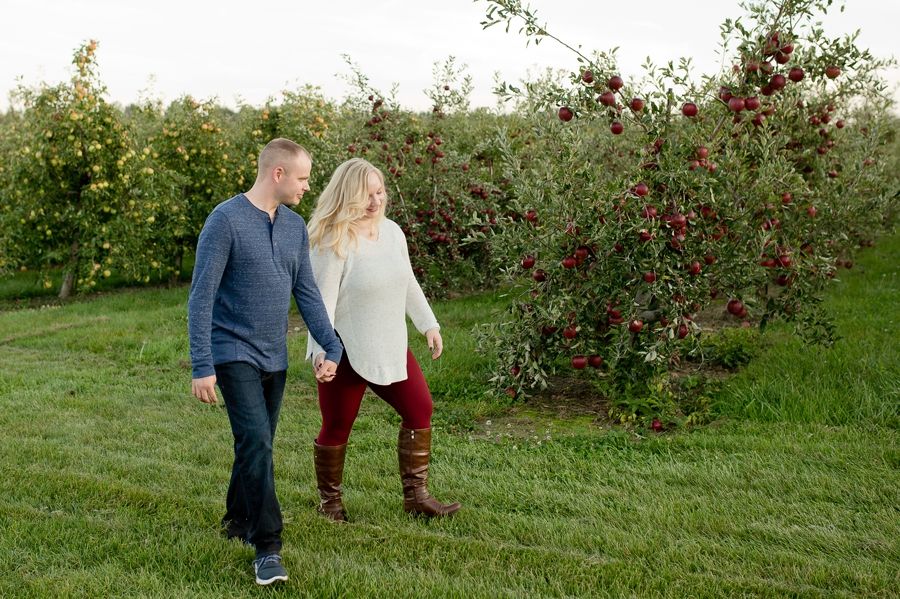 Lynd's Fruit Farm engaged couple walking through apple orchard
