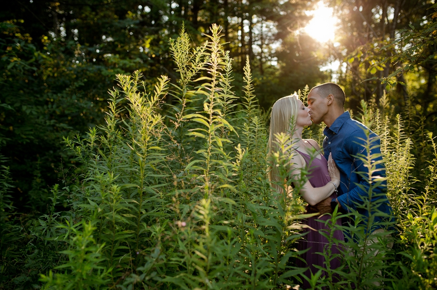 engaged couple kissing in field at Slate Run Canal Winchester