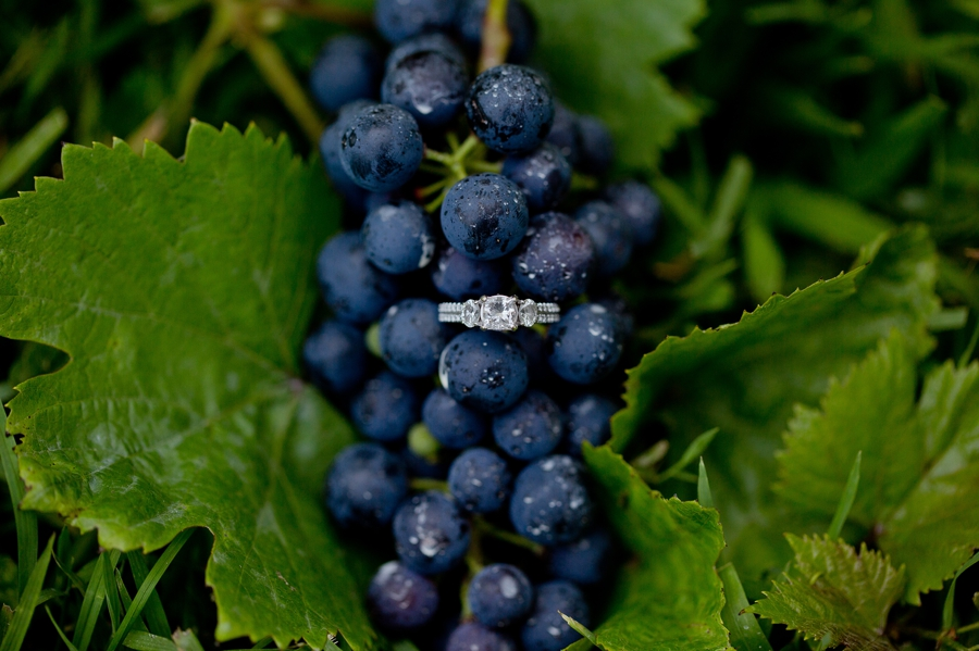 engagement ring on grapes at vineyard in Canal Winchester