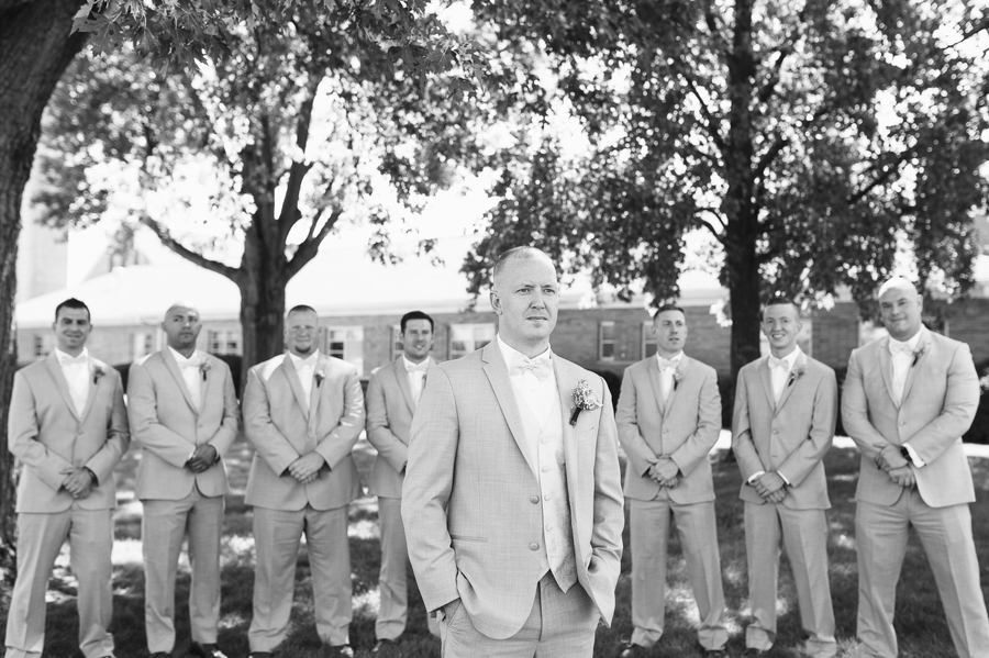 black and white photo of groom with groomsmen
