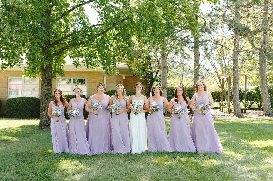 bride and bridemaids with arms crossed