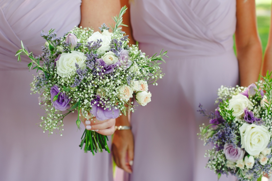 bridesmaids bouquets with baby's breath and lavender roses