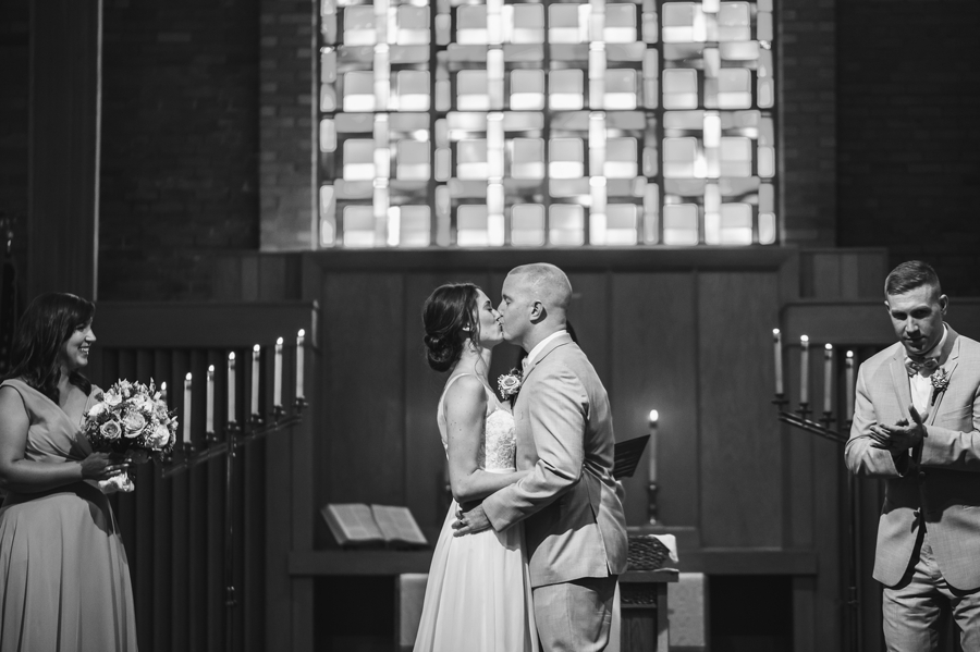 bride and groom kissing for first time