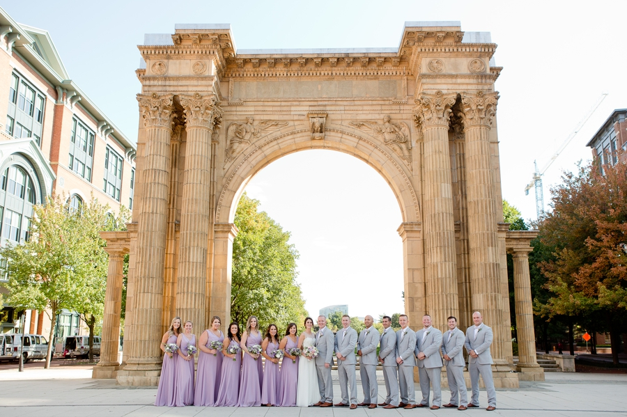 wide photo of wedding party at nationwide arena at Rustic Barn Wedding