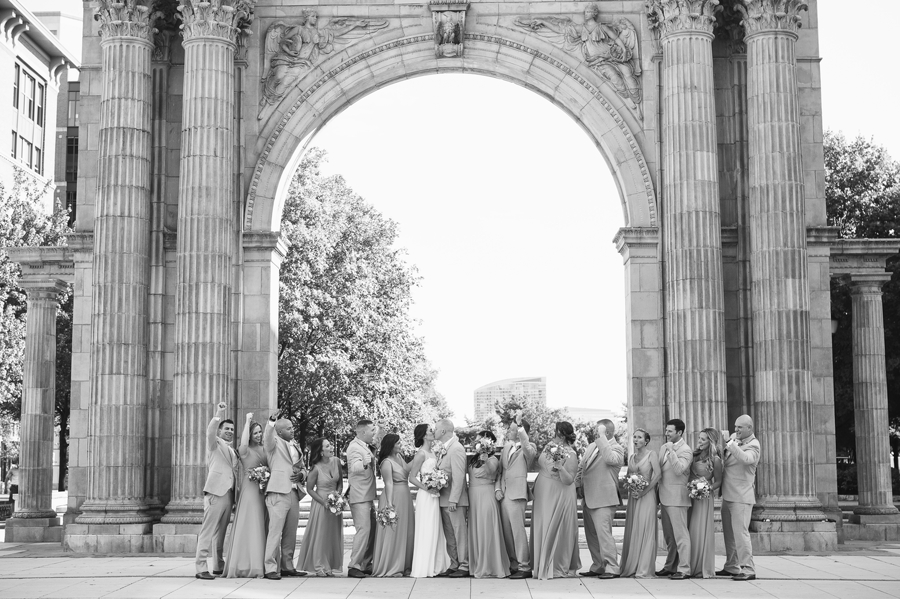 black and white wide photo of wedding party at nationwide arena arch