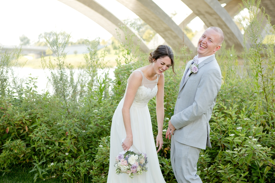bride and groom laughing at scioto mile at Rustic Barn Wedding