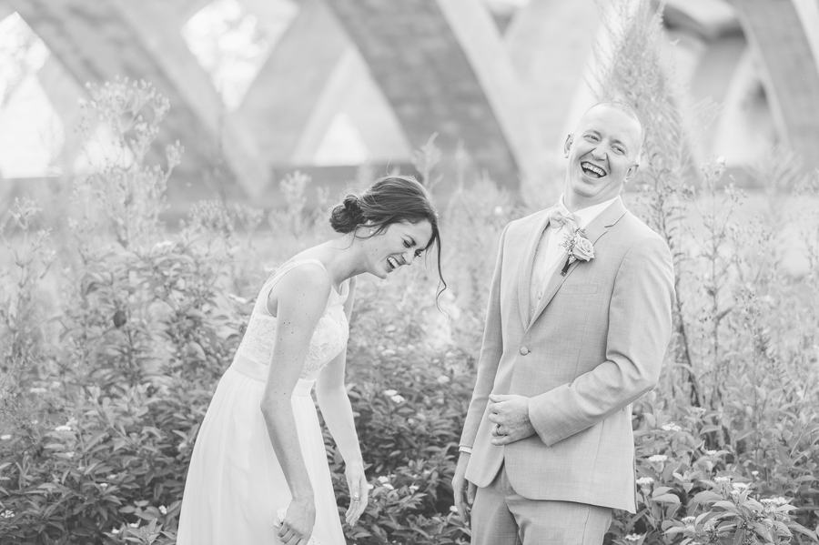 black and white photo of laughing bride and groom