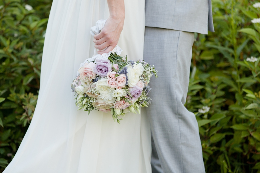blose up of brides bouquet hanging down at Rustic Barn Wedding