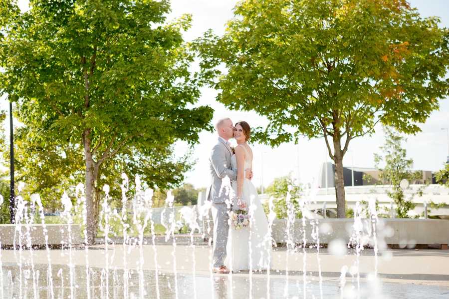 bride and groom at water fountains at scioto mile at Rustic Barn Wedding