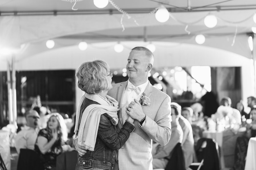 black and white photo of groom dancing with aunt