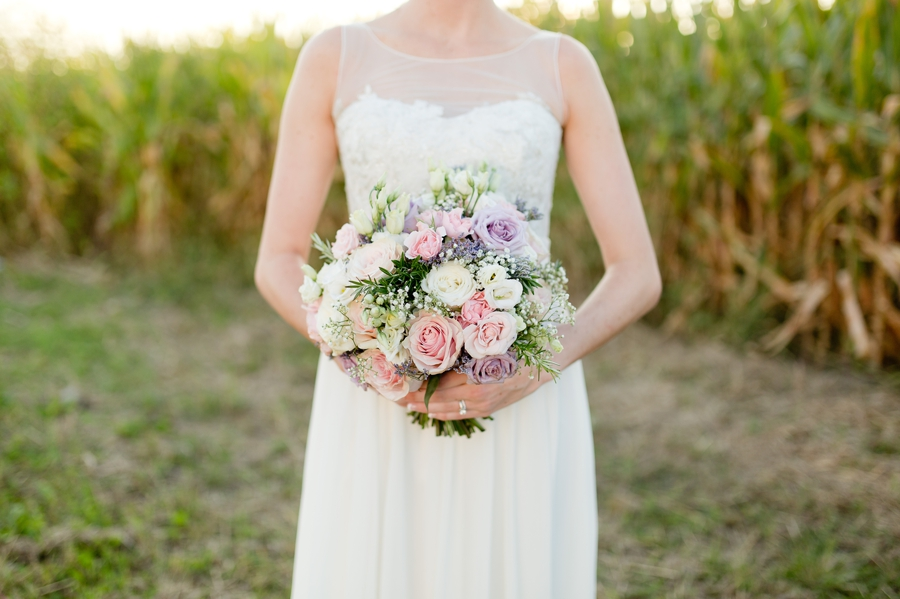 close up of brides lavender and pink rose bouquet