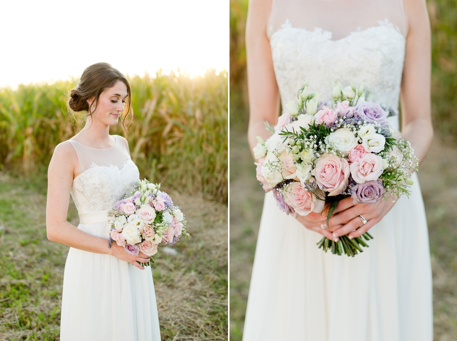 bride looking down at bouquet at Rustic Barn Wedding
