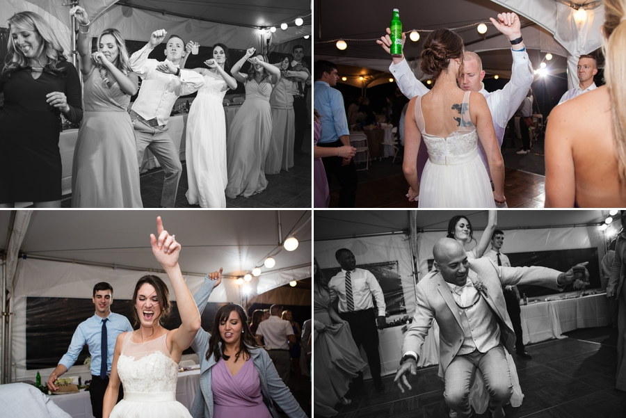 bride dancing with hands in the air at Rustic Barn Wedding