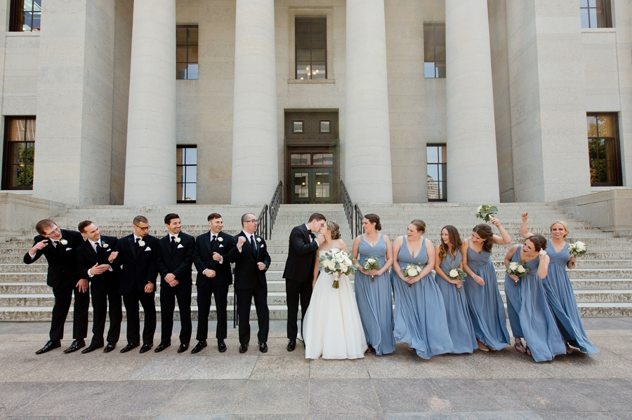 bridal party cheering on bride and groom at statehouse
