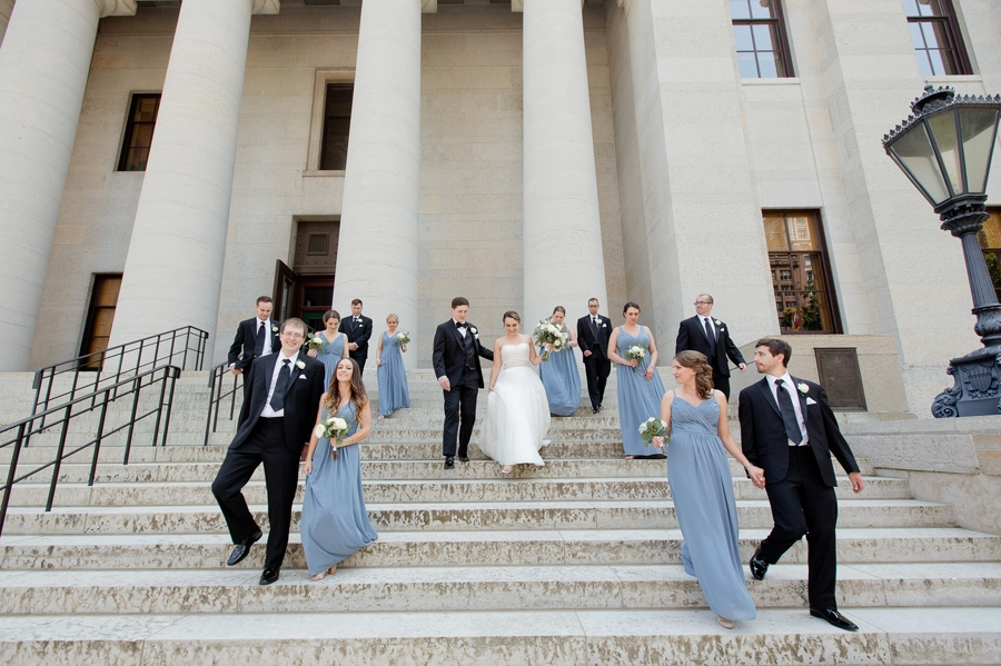 wedding party walking down stairs at statehouse