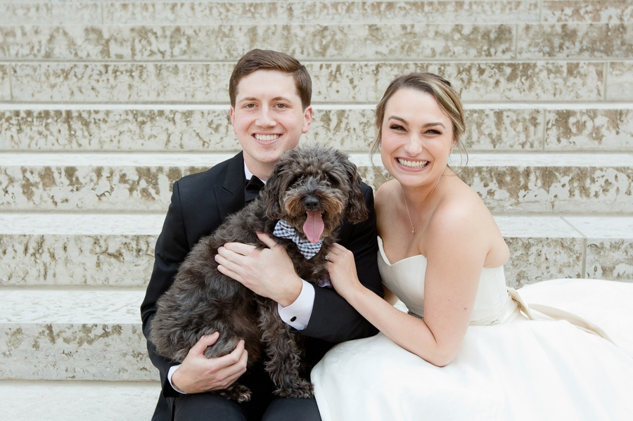 bride and groom posing with their dog at ohio statehouse