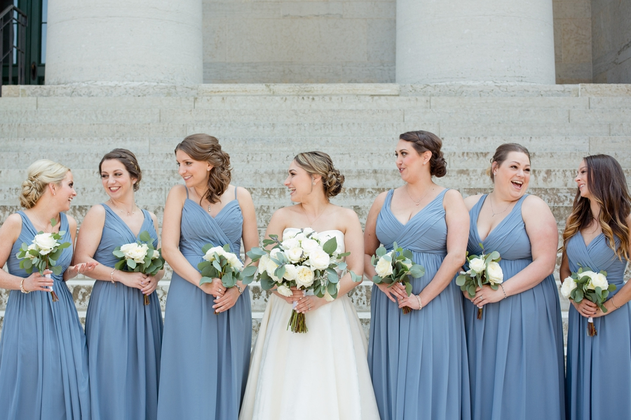 bride and bridesmaids laughing at ohio statehouse wedding