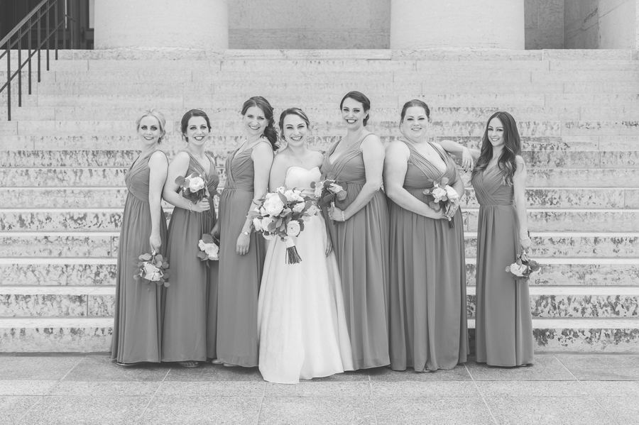 black and white photo of bride with bridesmaids at ohio statehouse
