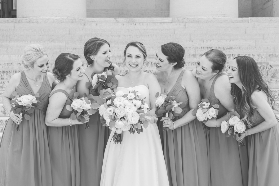 laughing bride at ohio stathouse with bridesmaids