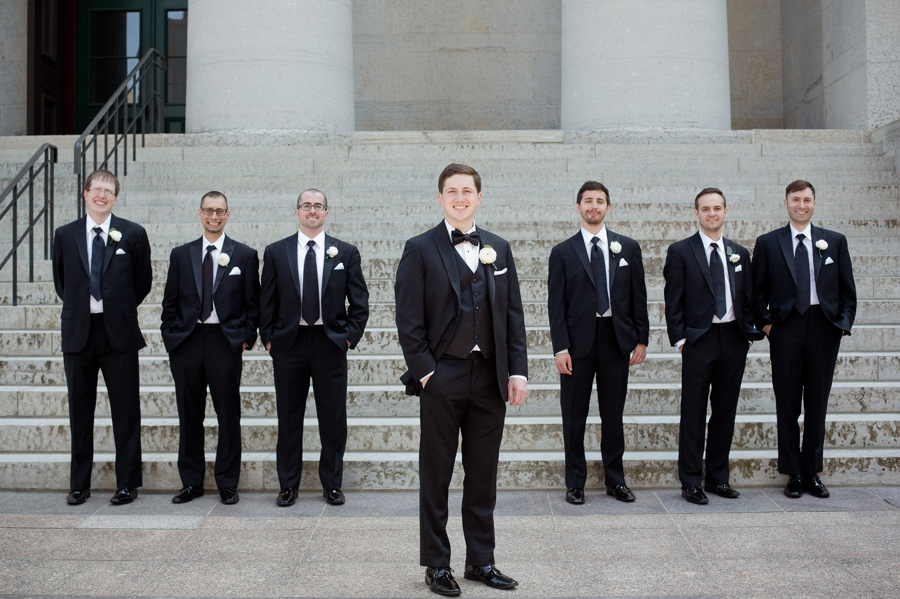 groom smiling with groomsmen at ohio statehouse
