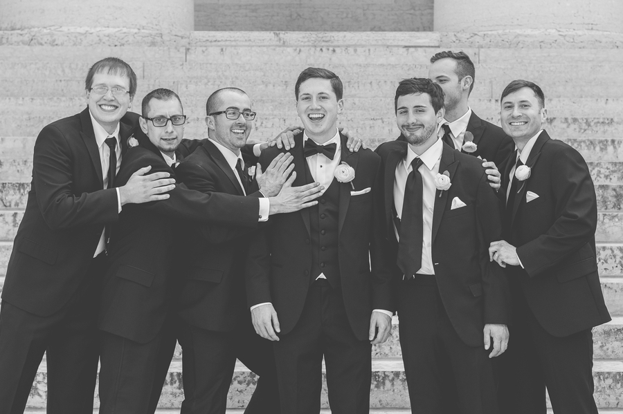 black and white photo of groomsmen with groom at statehouse wedding