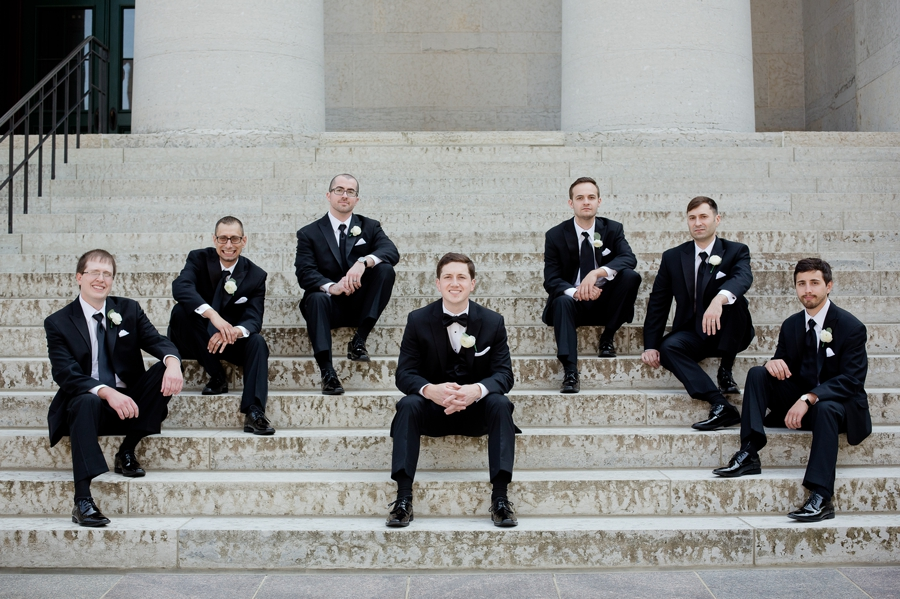 groom and groomsmen sitting on stairs at ohio statehouse