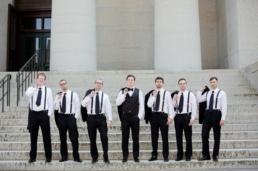 groom and groomsmen with jackets over shoulder at ohio statehouse