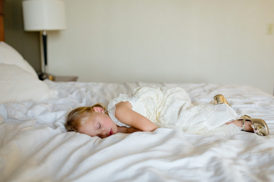 little girl taking a nap before wedding