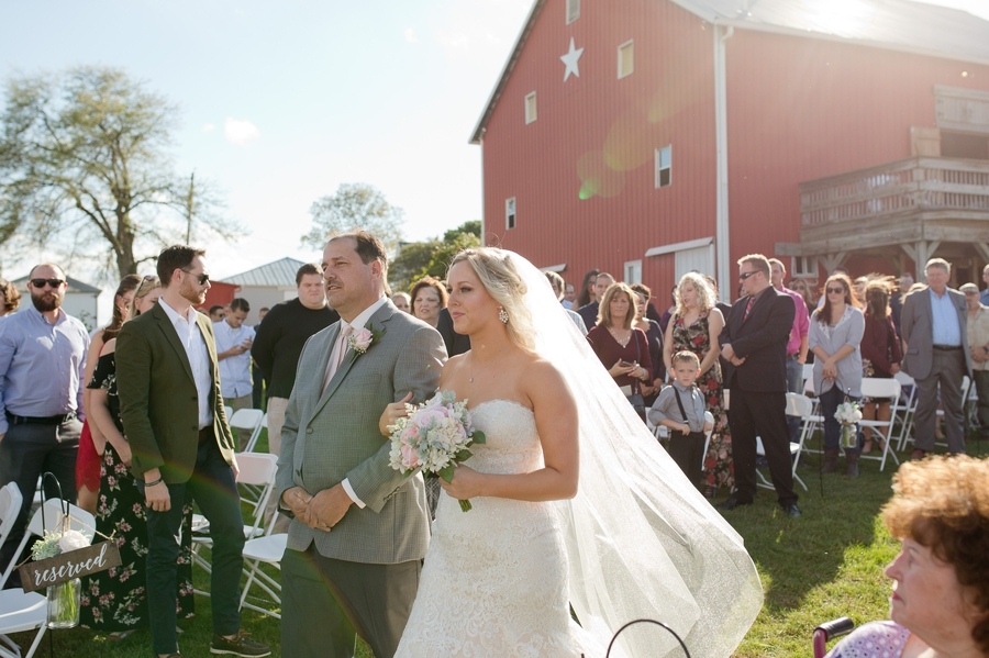 bride walking down aisle at a barn wedding in ohio