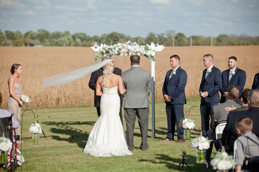 brides veil flying in the wind at a barn wedding in ohio ceremony