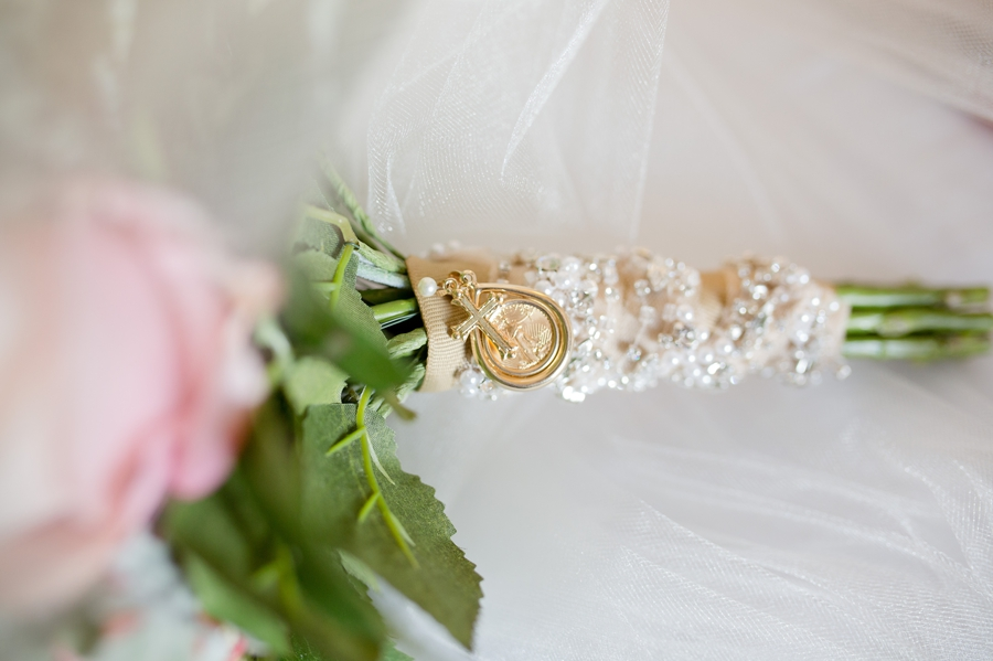 close p photo of brides bouquet wrap with pearls