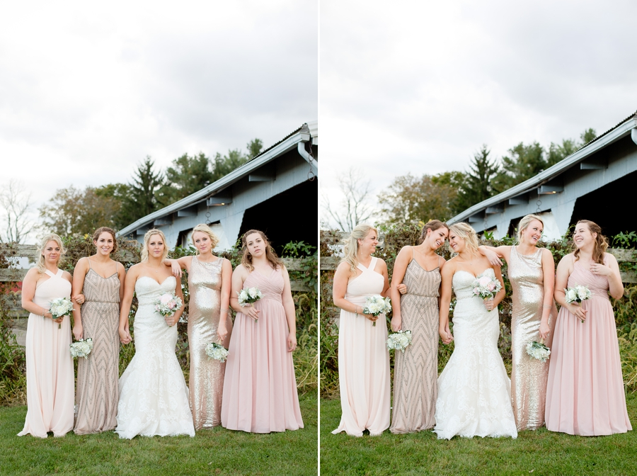 bridemaids holding hands at a barn wedding in ohio