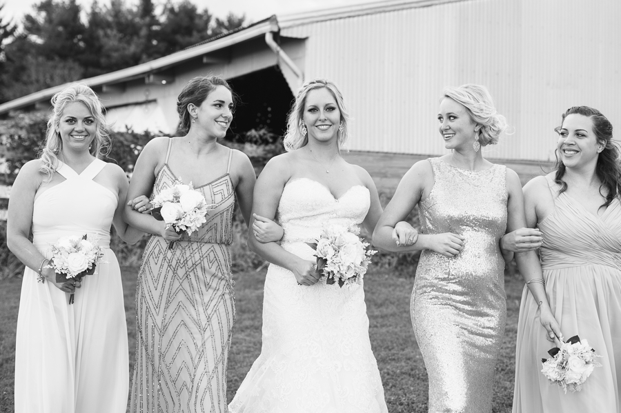 black and white photo of bride and bridemaids walking