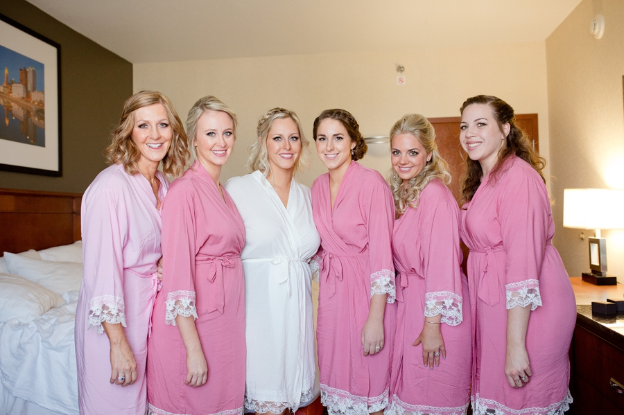 bride and bridemaids in pink robes at a barn wedding in ohio