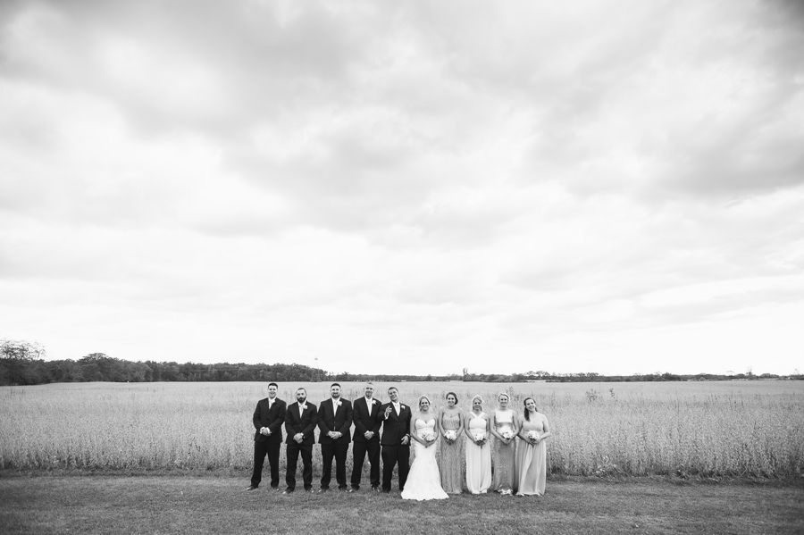 wide black and white photo of wedding party at a barn wedding in ohio