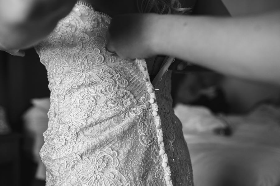 close up black and white photo of brides dress