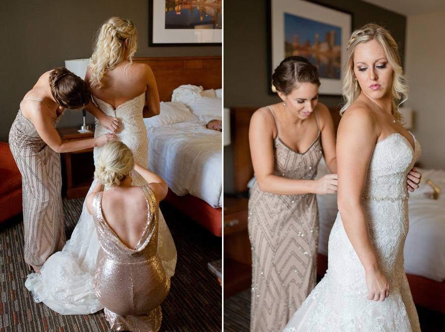 bridemaids helping bride get dressed at a barn wedding in ohio