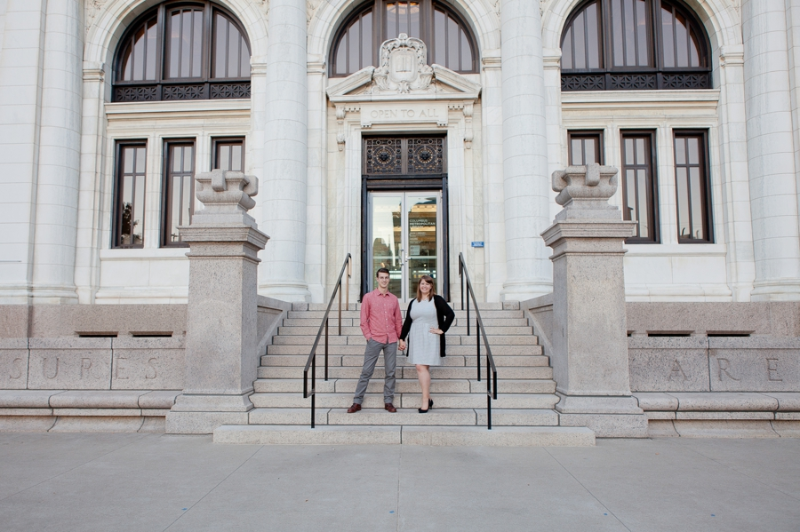 engaged couple holding hands at Columbus Metropolitan Library