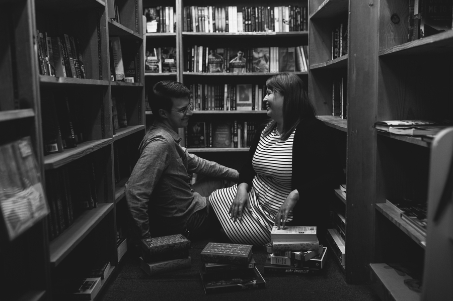 black and white photo of engaged couple in library at Columbus Metropolitan Library